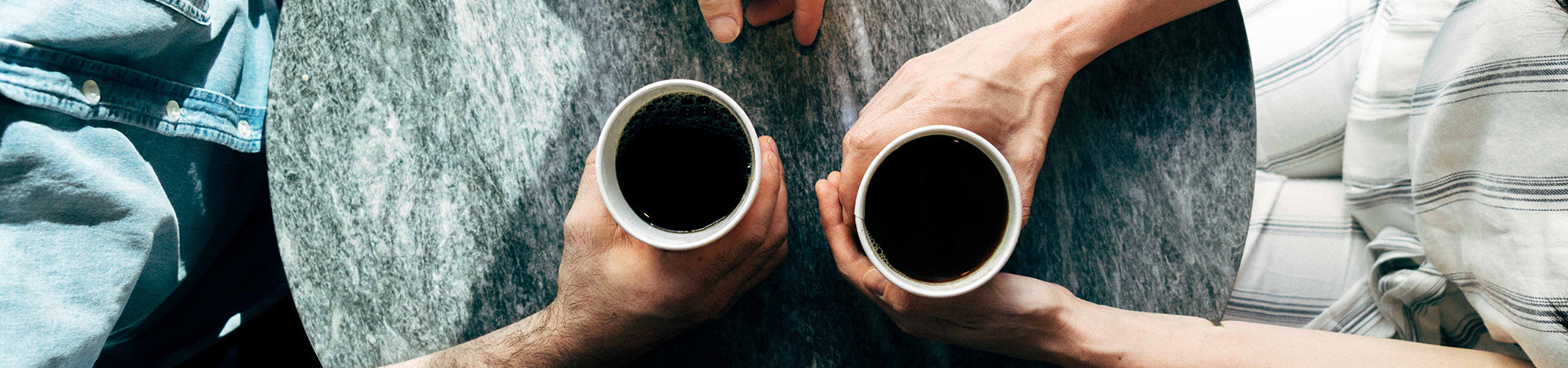 adults-talking-over-coffee